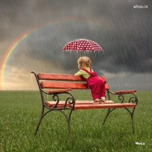 small-child-watching-a-colorful-rainbow